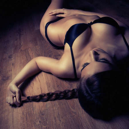 nice breast: beautiful girl in black lingerie on timber floor Stock Photo