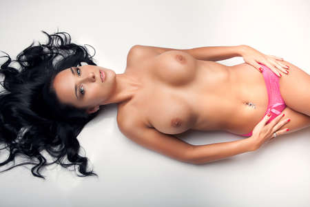 topless brunette: brunette topless slim lying girl with big breasts