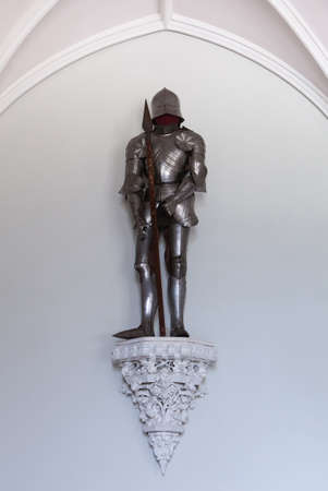 full metal jacket: vintage european full body armor suit on castle wall Editorial