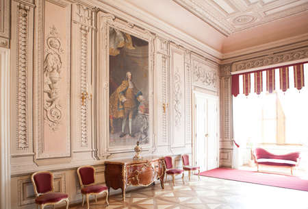 luxury interior chateau in europe, old furniture and big painting Editorial