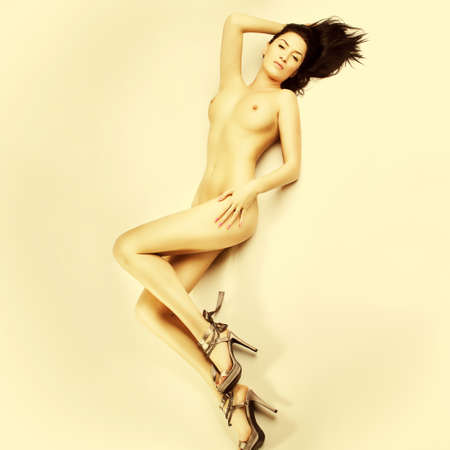 naked woman  white background: sexy nude girl with big breasts on floor