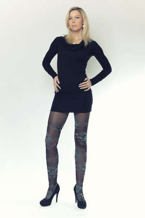 long legs: attractive blonde girl with long legs in black dress