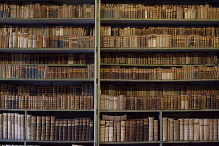 historic old books in ancient library, wooden bookshelf