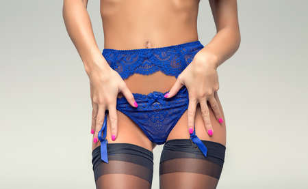torso sexy slim girl with blue suspender belt and panties