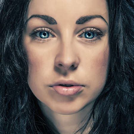 beauty eyes: beauty portrait brunette cute girl with blue eyes