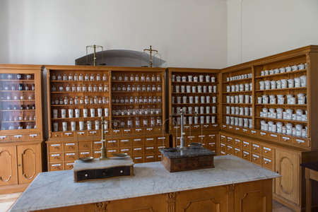 medical cabinet: Empty chemical bottles in old vintage pharmacy Stock Photo