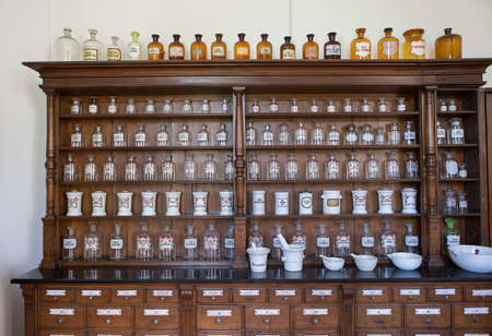 Empty chemical bottles in old vintage pharmacy Foto de archivo
