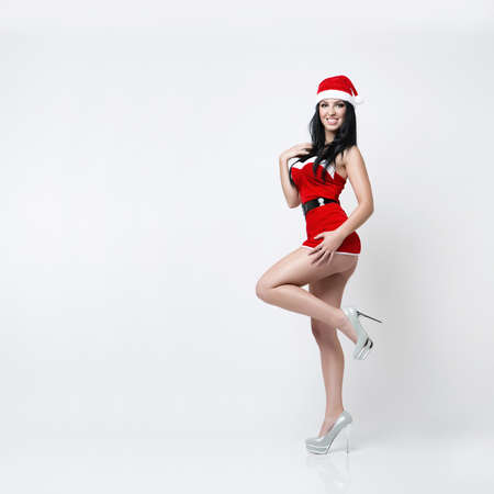 sexy santa claus: very beautiful and sexy girl dresses as a sexy santa claus Stock Photo