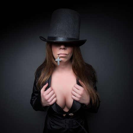 fetish dark portrait glamour girl in hat with cross
