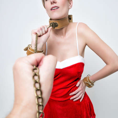 bondage girl in red costume nad cap santa claus