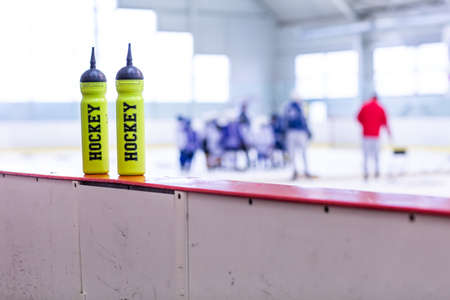 training ice hockey rink, bottle on board