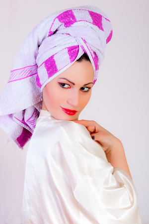 Portrait of woman with towel on her head photo