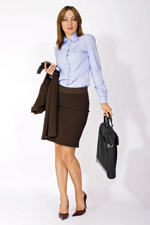 portrait of attractive businesswoman with briefcase