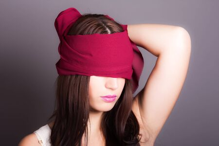 portrait of a woman with covered eyes Stock Photo