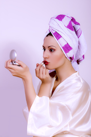 portrait of woman applying make up photo