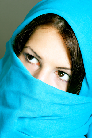 portrait of beautiful arabic woman wearing scarf photo