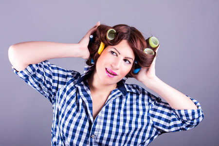 sexy housewife: portrait of sexy housewife with curlers Stock Photo