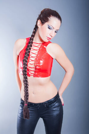 long pants: portrait of beautiful brunette wearing leather outfit