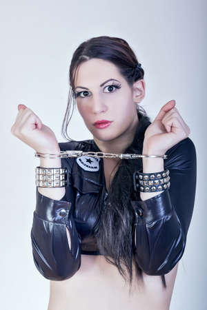 portrait of sexy girl with handcuffs photo