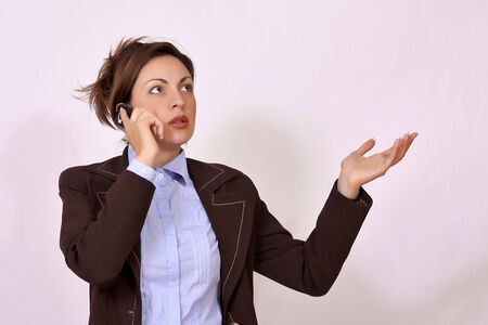 portrait of business woman talking on the phone photo