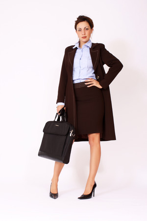 portrait of young attractive businesswoman with briefcase photo