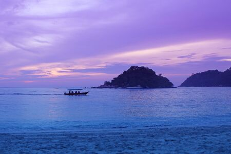 beautiful purple romantic sunset on the sea, islands darken in the distance, asia, vacation concept, travel