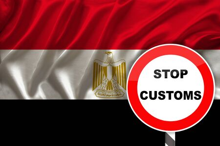 customs sign, stop, attention on the background of the silk national flag of Egypt, the concept of border and customs control, violation of the state border, tourism restrictions