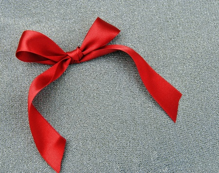 red bow isolated on grey background Stock Photo - 9474738