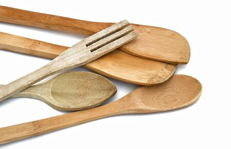 eating utensils: Covered wood isolated on white background