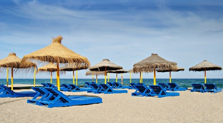 loungers: View of a beach with sun loungers and umbrellas Stock Photo