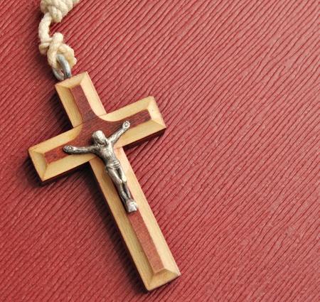 Catholic Cross of Jesus Christ located obliquely on a red background 版權商用圖片