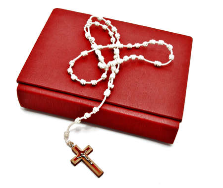 Catholic Rosary on a bible, surrounded by white 版權商用圖片