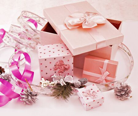 Several colored boxes with ribbons next to each other Stock Photo - 9770452