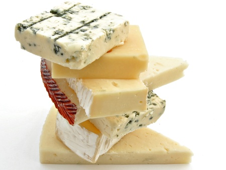 french cuisine: Cheeses from different classes placed on each other surrounded by white