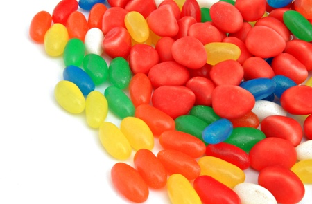 Jellybeans of different colors stacked side by side photo