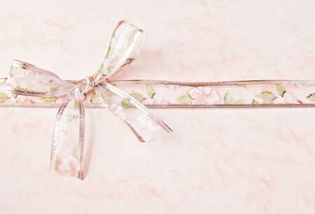 Ribbon transparent decorated with flowers on pink background blur Stock Photo - 9905867