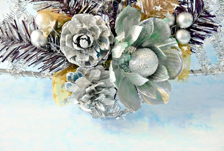 Ornament consisting of pineapple, flowers and beads surrounded by blue blur photo