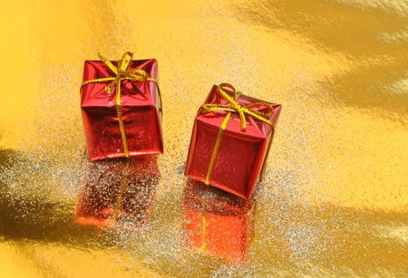 Two Christmas gift boxes surrounded by bright background photo