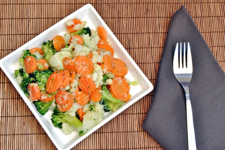 Vegetable dish consisting of carrots, broccoli and cauliflower photo