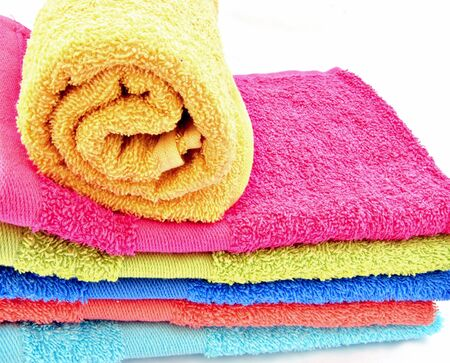 clustered: Towels of various colors, one rolled