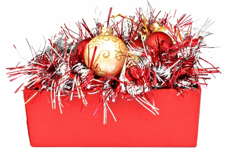 Red box with  Christmas balls and tinsel, surrounded by white photo