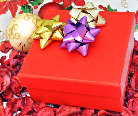 Red box with Christmas golden ball on Christmas decorations photo