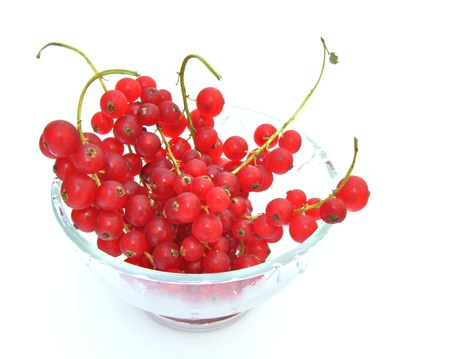 Cluster of several red gooseberries color in a glass jar , surrounded by white background Stock Photo