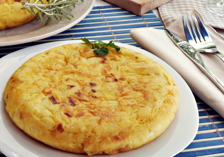 tortilla: Omelette served on a plate decorated with the bottom potato omelette Stock Photo