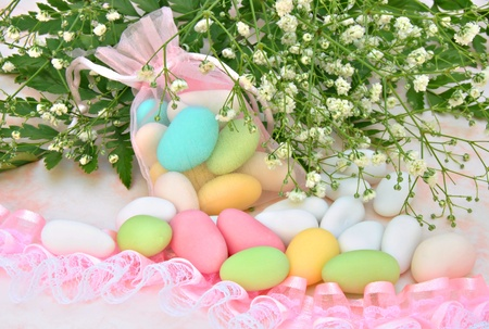 Sugared colors in a basket with flowers in the background Stock Photo - 10799169