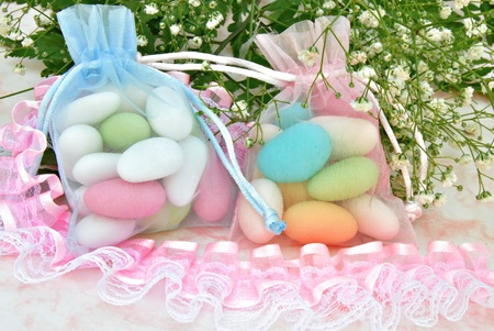 Sugared colors in a basket with flowers in the background photo