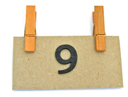 Label in the form of colored rectangle with number nine, surrounded by white background Stock Photo - 11085042
