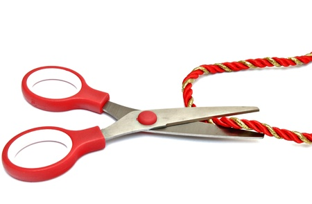 Scissors cutting a cord, surrounded by white background photo