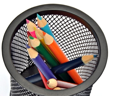 Pencils of various colors next to each other, within a pen photo