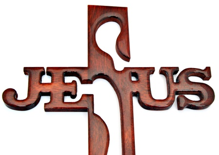 christian faith: Crucifix, carved with the word jesus on top, surrounded by white background